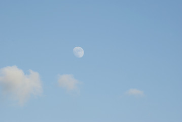 The moon and cloud on blue sky