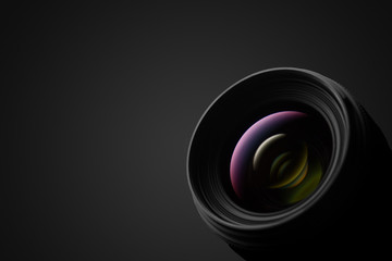Camera lens close up on dark background