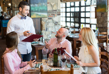 Company ordering food in restaurant