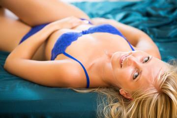 Beautiful blonde posing in bedroom
