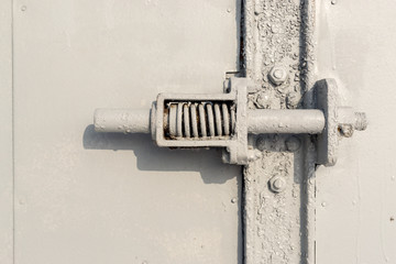 Close up of Grey Pained Metal Spring Door Handle