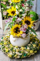 Floral arrangement with sunflowers and matthiolas