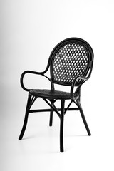 Black wicker chair on a gray background