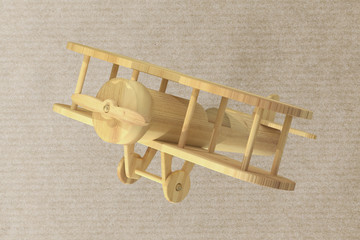 Wooden airplane on paper textured background