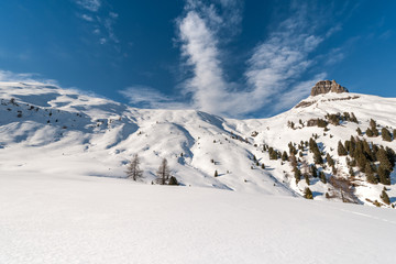 Winter ski area Ciampac in Dolomites, Italy, with Crepa Neigra mountain in the background