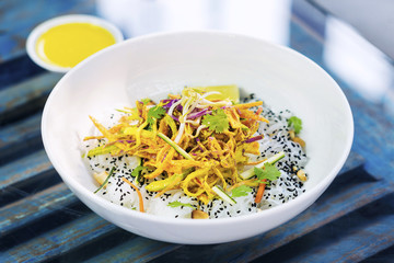 curry sauce vegetable salad with noodles and sesame