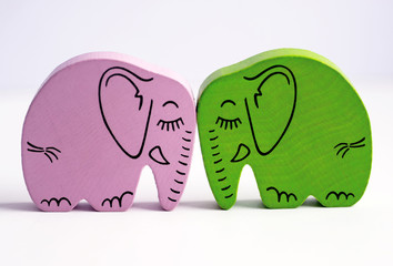 Pink and Green Wooden Elephants Kissing