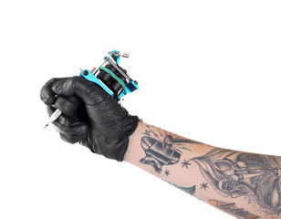 Tattooist hand in black glove with tattoo machine isolated on white background, close up