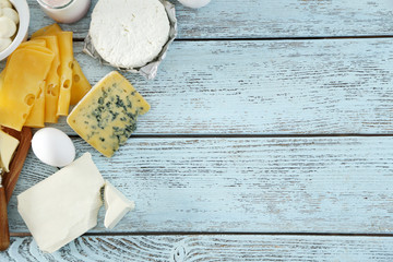 Frame of fresh dairy products on blue wooden table