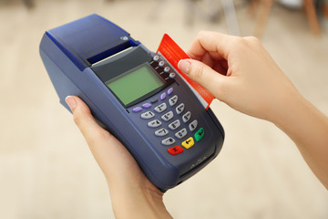 Female hands with credit card and bank terminal