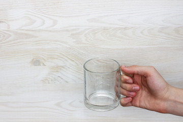 vital necessity in water/empty transparent glass of water in her hand