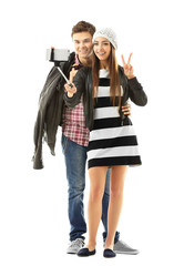 Teenager couple making photo by their self with mobile phone, isolated on white