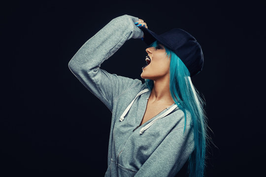 Sexy hip hop woman with cap in hoodie