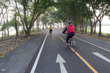 Peple cycling in park