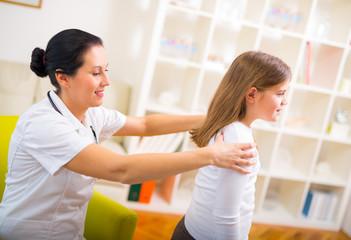 Chiropractor doing adjustment on female patient
