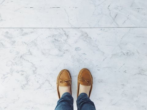 selfie of woman wearing leather shoes on marble floor