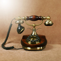 Retro wooden telephone on brown velvet