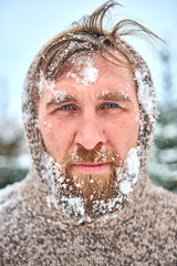 Portrait of bearded man with snow on his face