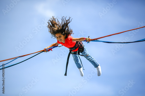 girl bungee jumping trampoline stockfotos und. Black Bedroom Furniture Sets. Home Design Ideas