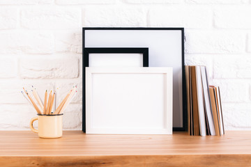 Pencils, frame and books