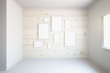 Light wooden wall with frames