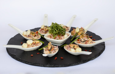 "Peruvian food: ""Choros a la chalaca"", mussels seasoned with onion"