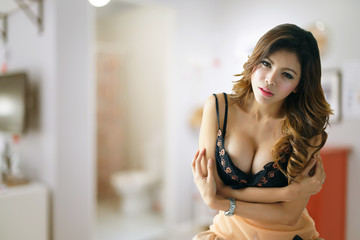 Young beautiful Asian woman in sexy lingerie.