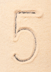 5 number written on sand