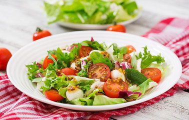 Dietary salad with tomatoes, mozzarella lettuce with honey-mustard dressing