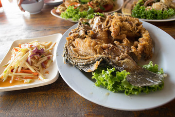 Fried Fish With Fish Sauce eating with mango salad