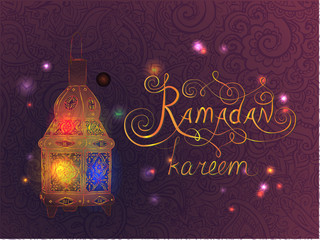 Ramadan kareem text with ornamental lantern lamp. Vector