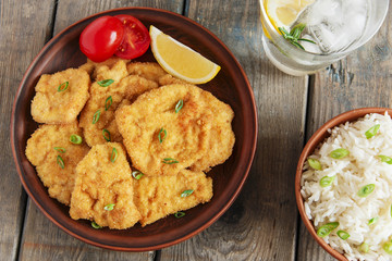 roasted schnitzel chop escalope with lemon tomato rice