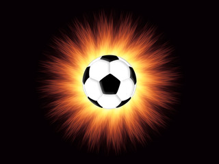 Football and flame on the black background