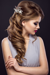 Beautiful  girl with perfect skin, evening make-up, wedding hairstyle and accessories. Beauty face.
