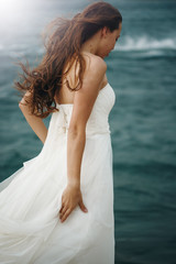 Woman in White near Stormy Sea