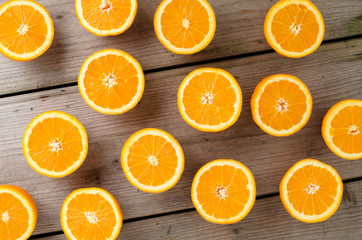 Overhead shot of oranges on an old wooden table