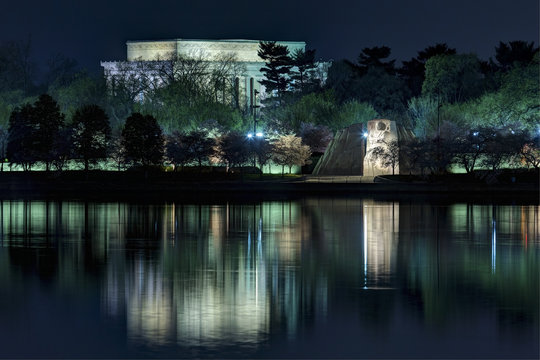 Lincoln Memorial and Martin Luther King Memorial reflecting in the Tidal Basin in Washington, DC.
