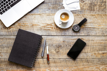Working place with notebook on wooden table