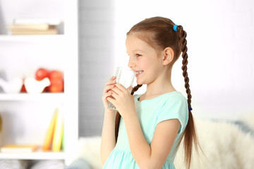 Girl drinking water in the room