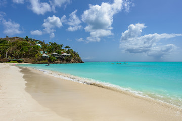 Tropical beach at Antigua island in Caribbean with white sand, t
