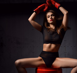 Beautiful sexy woman with red Boxing Gloves at the gym concept a