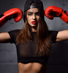 sexy woman with red Boxing Gloves at the gym concept about sport