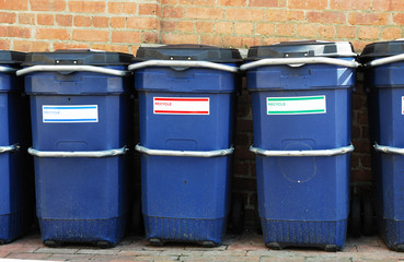 outdoor trash bins in a row