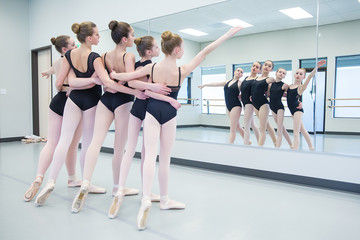 Group of ballerinas in mirror