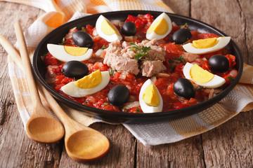 Traditional Tunisian salad with tuna, eggs, and vegetables. horizontal