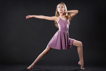 Portrait of young dancer in dramatic pose