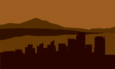 Silhouette of city with mountain background