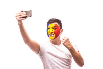 Romanian football fan take selfie photo with phone on white background. European 2016 football fans concept.