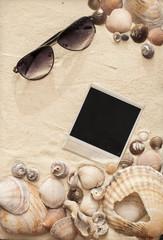 sea shells, sunglasses and polaroid picture