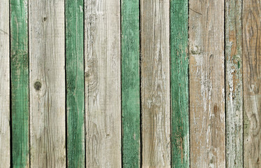 Green and gray wooden fence texture.